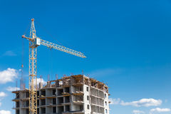 The construction crane and  building Stock Images