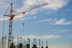 The construction crane and the building against the blue sky Stock Photo