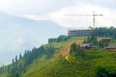 Construction crane building on hilltop Stock Images