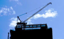 Construction Crane building silhouette Stock Image