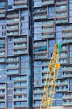 The construction crane and the building Stock Photos