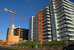 Construction crane and buildings stock photography