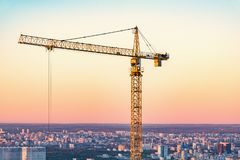 Construction crane on the city background. royalty free stock image