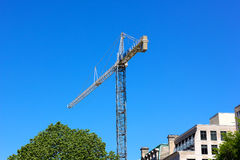 Construction crane in the city. Stock Image