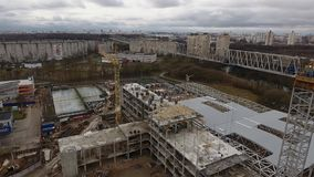 Construction platform aerial view in autumn. Construction crane in the city of Minsk autumn aerial survey building site gloomy mood stage construction stock video footage