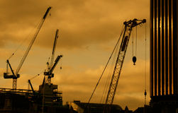 Construction crane in city sunset Royalty Free Stock Photography