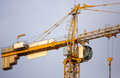Construction Crane. A close view of a construction crane with clear blue sky background stock photos