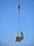 Construction Crane with Concrete Blocks Stock Photo
