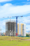 Construction crane and concrete building construction Stock Images