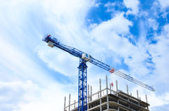 Construction crane and concrete building construction Stock Photo