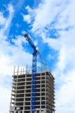 Construction crane and concrete building construction Royalty Free Stock Photo