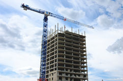 Construction crane and concrete building construction Royalty Free Stock Images