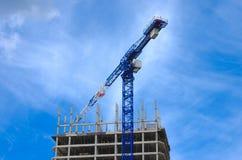 Construction crane and concrete building construction Stock Photography