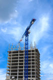 Construction crane and concrete building construction Stock Photo