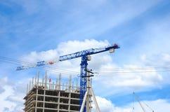 Construction crane and concrete building construction Royalty Free Stock Photos