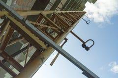 Construction crane. Near abandoned house Royalty Free Stock Photo