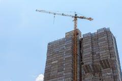 Construction Crane at construction site Stock Photos