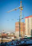 Construction crane at a construction site in winter city center Royalty Free Stock Photos