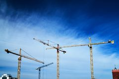 Construction crane constructions. Against the sky Royalty Free Stock Photography