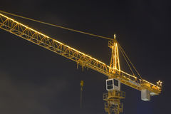 Construction crane decorated for Christmas (6518). Shot of a construction crane lit up with Christmas lights in the evening Royalty Free Stock Photos