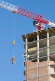 Construction crane. Delivers the concrete to build a house Stock Images
