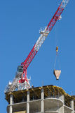 Construction crane. Delivers the concrete to build a house Royalty Free Stock Photography