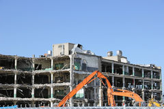 Construction Crane demolishing a building Royalty Free Stock Image