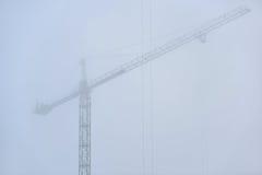 Construction crane in dense fog Stock Images