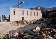 Construction crane erects a building Stock Image