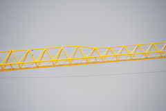 Construction crane filtered grey sky Stock Image