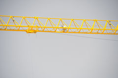 Construction crane grey sky backdrop Royalty Free Stock Images