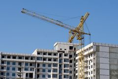 Construction crane and high-rise building under construction stock images