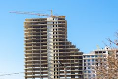 Construction crane and high-rise building under construction royalty free stock images