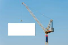 Construction crane holding a blank billboard Royalty Free Stock Photos