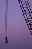 Construction crane hook and structure  at dusk or Royalty Free Stock Photo