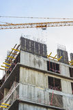 Construction crane and the house during construction Royalty Free Stock Images