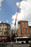 Construction crane in Innsbruck centre Stock Photo