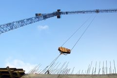 Construction crane lifts the load royalty free stock image