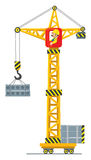 Construction crane lifts the load Royalty Free Stock Photography