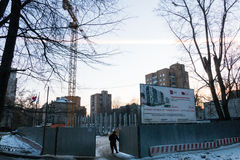 Construction crane with a load on the construction of a new home. 2016 Moscow stock photography