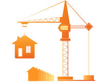 Construction crane and many houses Stock Photos