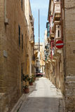 Construction crane on the narrow street Vittoriosa. Construction crane on the Maltese narrow street Vittoriosa Stock Image