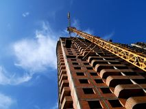 Free Construction Crane Near Building On Blue Sky Background. Royalty Free Stock Image - 104173906