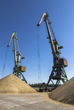 Construction crane near the pile of sand Stock Images
