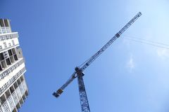 Construction crane and newly built high-rise residential buildin stock image