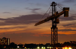 Construction crane at night. With city in the background stock images