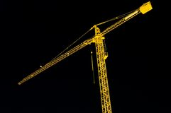 Construction crane by night Royalty Free Stock Photo
