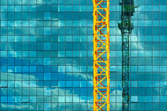 Construction crane and office building Royalty Free Stock Image