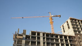 Construction crane in operation. Construction crane in work, building a house stock video