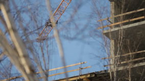 Construction crane in operation. Construction crane in work, building a house stock footage